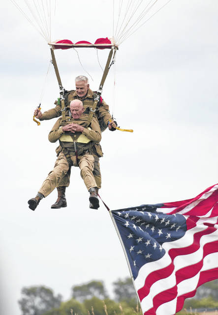 U.S. World War II D-Day veteran Tom Rice, from Coronado, Caalifornia, parachutes in a tandem jump into a field in Carentan, Normandy, France. Approximately 200 parachutists participated in the jump over Normandy on Wednesday, replicating a jump made by U.S. soldiers on June 6, 1944 as a prelude to the seaborne invasions on D-Day. (AP Photo)