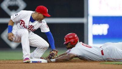 Cincinnati's Yasiel Puig safely reaches second base for a a steal against Phillies second baseman Cesar Hernandez during Friday night's game in Philadelphia. (AP photo)