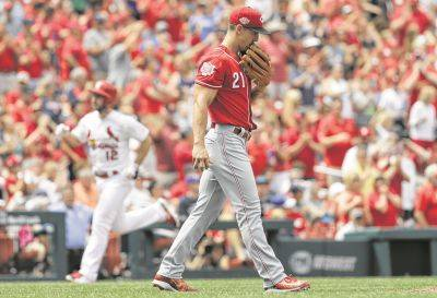 Cincinnati's Michael Lorenzen (21) walks back to the mound as tje Cardinals' Paul DeJong rounds the bases after hitting a two-run home run during Thursday's game in St. Louis.