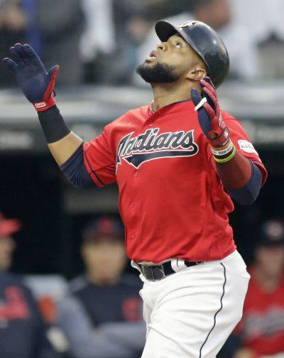 The Indians' Carlos Santana reacts to hitting a two-run home run during Friday night's game against the New York Yankees in Cleveland.