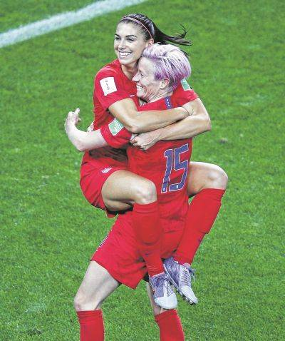 The United States' Alex Morgan, left, celebrates with teammate Megan Rapinoe (15) after Morgan recorded her fifth goal in Tuesday's Women's World Cup match against Thailand at the Stade Auguste-Delaune in Reims, France.