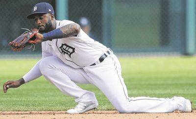 The Tigers' Niko Goodrum secures the ball for an out during Thursday's game against Tampa Bay in Detroit.