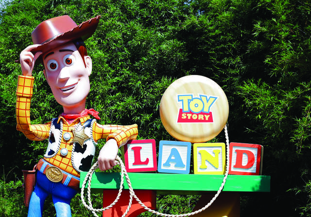 In this Saturday, June 23, 2018 photo, a statue of the character Sheriff Woody greets visitors at the entrance Toy Story Land in Disney's Hollywood Studios at Walt Disney World in Lake Buena Vista, Fla.