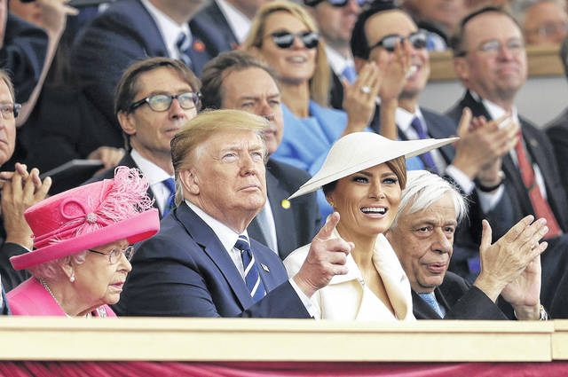 Queen Elizabeth II, President Donald Trump, first lady Melania Trump and Greek President Prokopis Pavlopoulos applaud as they watch a fly past at the end of an event to mark the 75th anniversary of D-Day in Portsmouth, England. (AP Photo/Matt Dunham)