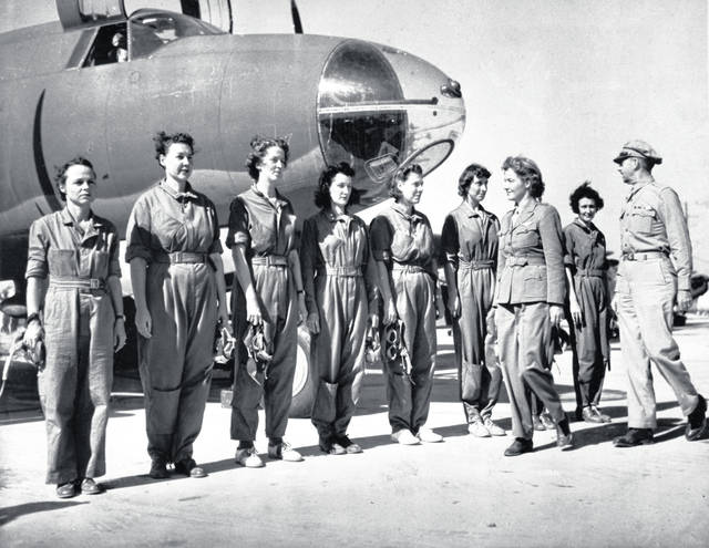 Aviator Nancy Harkness Love, director of the Women's Auxiliary Ferry Squadron (WAFS), and Col. Robert H. Baker, commanding officer, inspect the first contingent of women pilots in the WAFS at the New Castle Army Air Base, Del. Women didn't get much of a mention in the 75th anniversary commemorations of D-Day that focused largely on the fighting exploits of men, yet without women Adolf Hitler wouldn't have been defeated. Legions of women built weapons of war that men fought and killed with. By keeping production lines humming of planes, tanks and other material, they freed up men sent into combat on World War II fronts. (AP Photo, File)