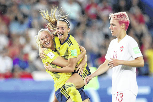 Sweden's Stina Blackstenius, left, celebrates after scoring the opening goal during the Women's World Cup round of 16 soccer match between Canada and Sweden at Parc des Princes in Paris, France, Monday.