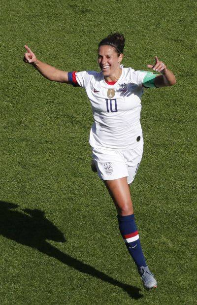 The United States' Carli Lloyd celebrates after scoring the opening goal during Sunday's World Cup match against Chile at the Parc des Princes in Paris. (AP photo)