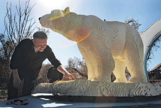 Lego artist Sean Kenney shows off a sculpture of a polar bear at the Hogle Zoo in Salt Lake City in April 2013. Iowa State University hired Kenney beginning in 2011 to make nature-themed sculptures out of thousands of Lego pieces for traveling exhibits known as Nature Connects. The school has paid the former Nature Connects director, Teresa McLaughlin, $225,000 to settle a lawsuit involving the program's finances.