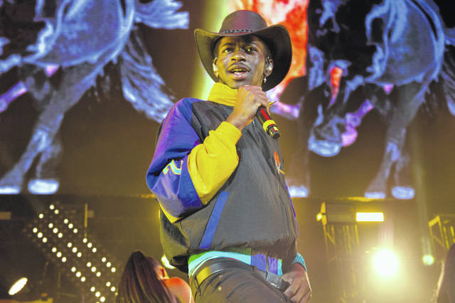 """Lil Nas X performs June 1 at HOT 97 Summer Jam 2019 in East Rutherford, N.J. The rapper has taken his """"Old Town Road"""" to the top of the Billboard charts for 16 weeks, tying a record set by Mariah Carey and Luis Fonsi."""