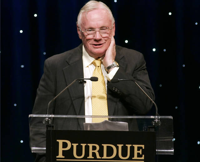 FILE - In this Friday, Oct. 26, 2007 file photo, former astronaut Neil Armstrong speaks during a dinner in his honor at Purdue University in West Lafayette, Ind. Court documents show that an Ohio hospital paid the estate of astronaut Armstrong $6 million to settle allegations that post-surgical complications led to his 2012 death. The 50th anniversary of Neil Armstrong's first steps on the moon was celebrated Saturday, July 20, 2019. (Michael Heinz/Journal & Courier via AP)