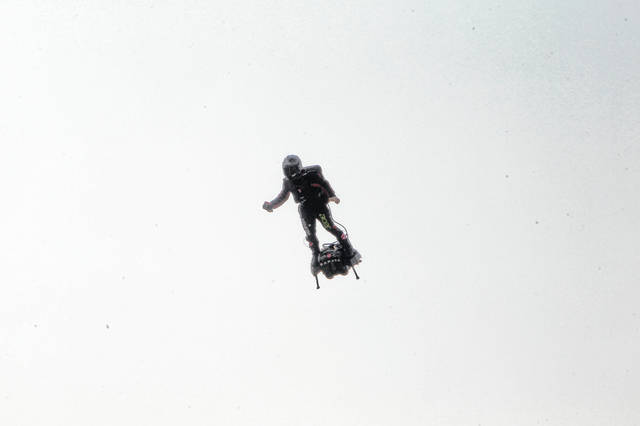 Franky Zapata, a 40-year-old inventor, takes to the air in Sangatte, Northern France, at the start of his attempt to cross the English Channel from France to England on Thursda. Zapata is anchored to his flyboard, a small flying platform he invented.