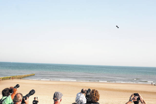 People on the shore watch as Franky Zapata, a 40-year-old inventor, takes to the air in Sangatte, Northern France, at the start of his attempt to cross the English channel on Thursday.
