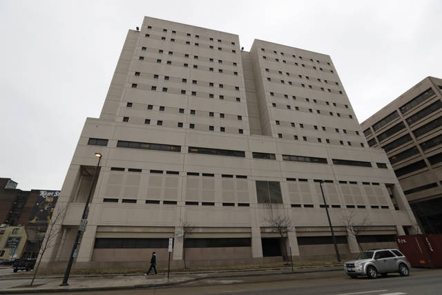 This photo from February shows the exterior of the Cuyahoga County Corrections Center in Cleveland. A memo obtained by The Associated Press shows a recent state inspection of the troubled county jail has found problems with medical care and other issues persist months after they were cited during previous inspections.