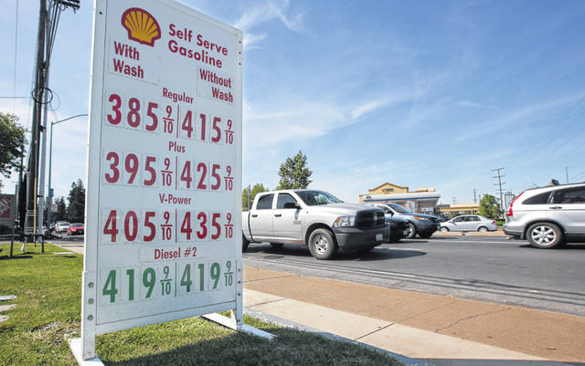 Gas prices are displayed at a Shell station in Sacramento, Calif., in April. Four major automakers have reached a secret deal with California to increase gas mileage and greenhouse gas emissions standards, bypassing the Trump administration's plan to freeze standards at 2021 levels, according to two people briefed on the matter.
