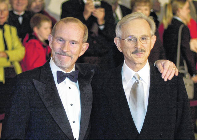 Tom Smothers, left, and Dick Smothers appear in 2002 at the Kennedy Center in Washington for the Mark Twain Prize for Humor Award ceremony honoring Bob Newhart. The duo stepped out of retirement to commemorate the day 50 years ago when CBS canceled their show over their political impudence.