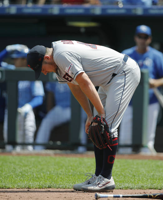 Cleveland Indians pitcher Trevor Bauer reacts near home plate after the Kansas City Royals scored a run in the fifth inning of a baseball game at Kauffman Stadium in Kansas City, Mo., Sunday, July 28, 2019. (AP Photo/Colin E. Braley)