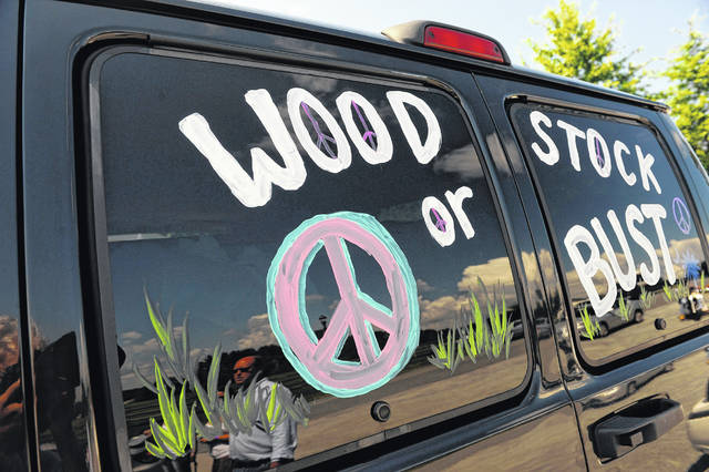 "This Aug. 14, 2009 file photo shows a van decorated with ""Woodstock or Bust"" at the original Woodstock Festival site in Bethel, N.Y. Woodstock 50 is officially cancelled, organizers announced Wednesday."
