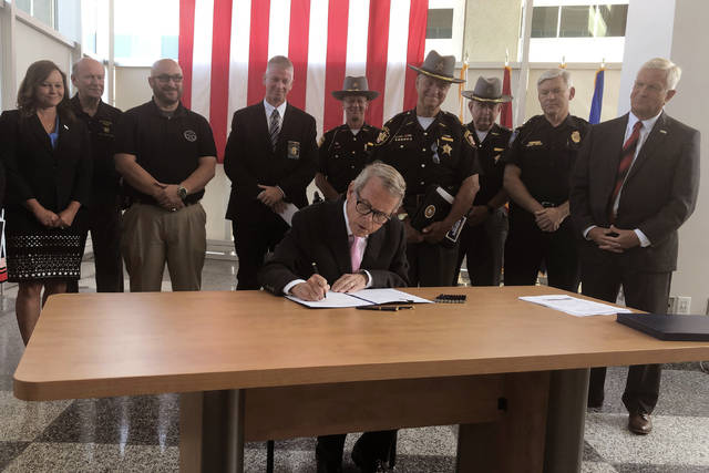 Ohio Gov. Mike DeWine signs an executive order creating a new state law enforcement unit to help enhance drug trafficking investigations Wednesday. In comments afterward, DeWine said the state continues to have problems finding drugs to use in lethal injection, partly out of concern that drugmakers opposed to their drugs being used in executions will retaliate by cutting off supplies of drugs the state buys for medicinal purposes.
