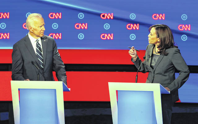 Former Vice President Joe Biden listens as Sen. Kamala Harris, D-Calif., speaks during the second of two Democratic presidential primary debates hosted by CNN on Wednesday in the Fox Theatre in Detroit.