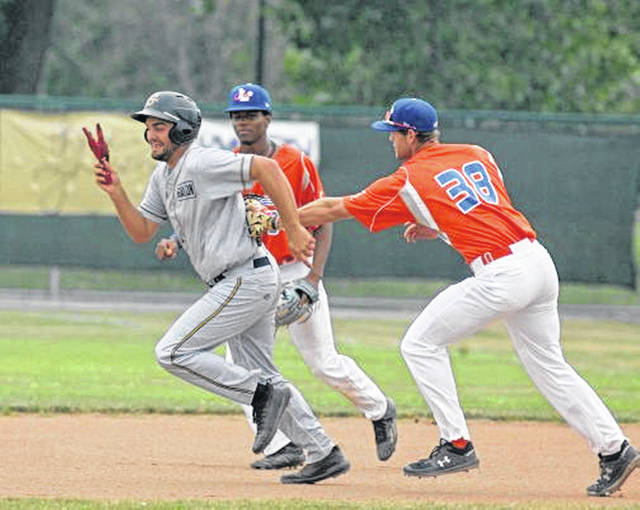 Lima Locos first baseman Jacob Penningston tagas out Galion's Sean McGlaughlin during a rundown at Simmons Field on Sunday.