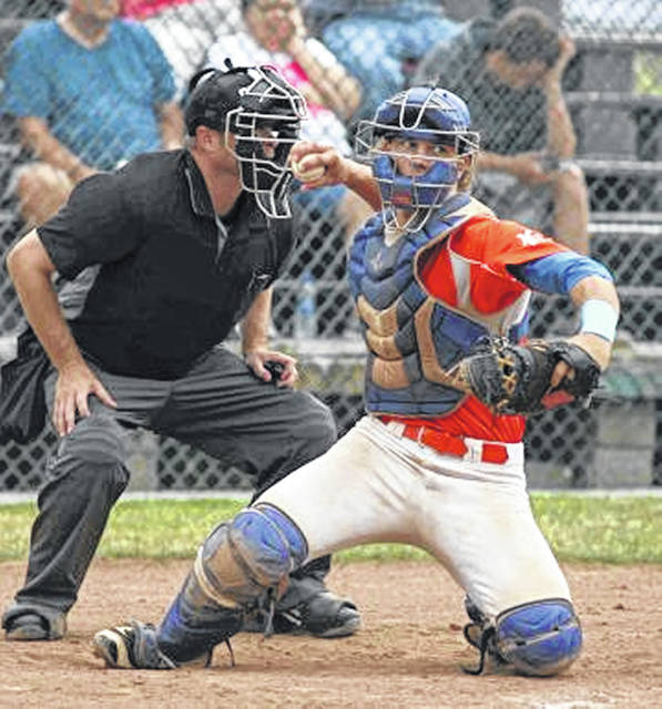 Lima Locos catcher Gavin Harmon sends a pick off throw to first base during the Locos' game against Galion on Sunday at Simmons Field.