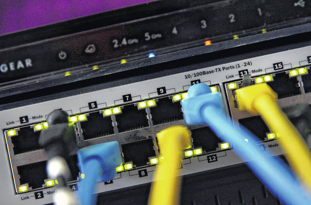 FILE - In this June 19, 2018, file photo, a router and internet switch are displayed in East Derry, N.H. The FBI said cyberattacks have become common at schools, which are attractive targets because they hold sensitive data and provide critical public services. Malicious use of the data could lead to bullying, tracking and identity theft, the agency said.
