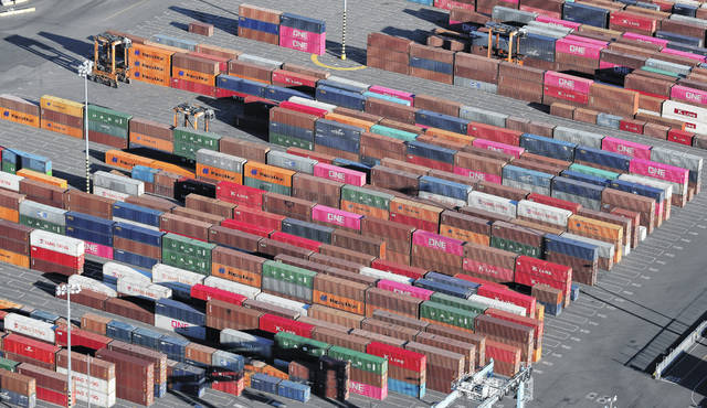 Cargo containers are staged near cranes in March at the Port of Tacoma, in Tacoma, Wash. Some are moving factories out of China. Others are strategically redesigning products. Some are seeking loopholes in trade law or even mislabeling where their goods originate, all with the goal of evading President Donald Trump's sweeping tariffs on goods from China.
