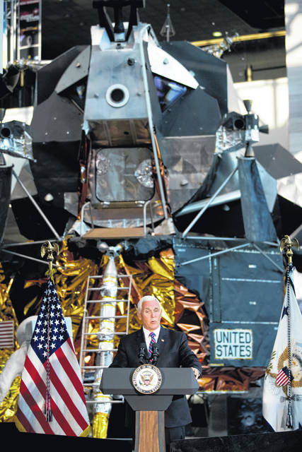 FILE - In this July 16, 2019 file photo, a lunar module, the same type that landed on the moon for Apollo 11, is displayed behind Vice President Mike Pence as he speaks before the unveiling of Neil Armstrong's Apollo 11 spacesuit at the Smithsonian's National Air and Space Museum on the National Mall in Washington. The White House wants U.S. astronauts on the moon by 2024, a scant five years from now. The moon will serve as a critical proving ground, the thinking goes, for the real prize of sending astronauts to Mars.