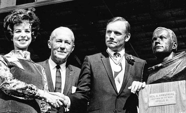 Neil Armstrong poses with a bronze bust of himself on Sept. 6, 1969, in Wapakoneta. Also pictured are, from left, sculptor Alba Hicks and Richard Brading, the owner of the pharmacy where Armstrong worked as a boy.
