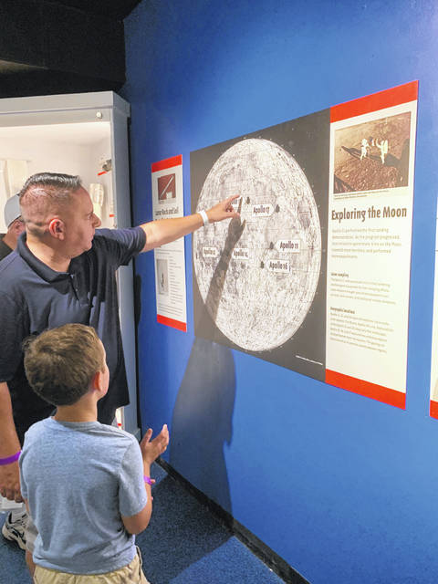 Dean Walther and his son, Austin, 7, explore the Armstrong Air and Space Museum Friday afternoon.