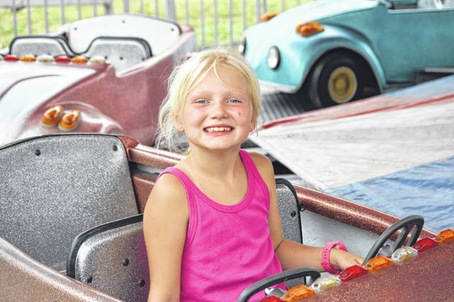 Breah Hummer, 8, of St. Marys, enjoys a ride Monday at the Auglaize County Fair.