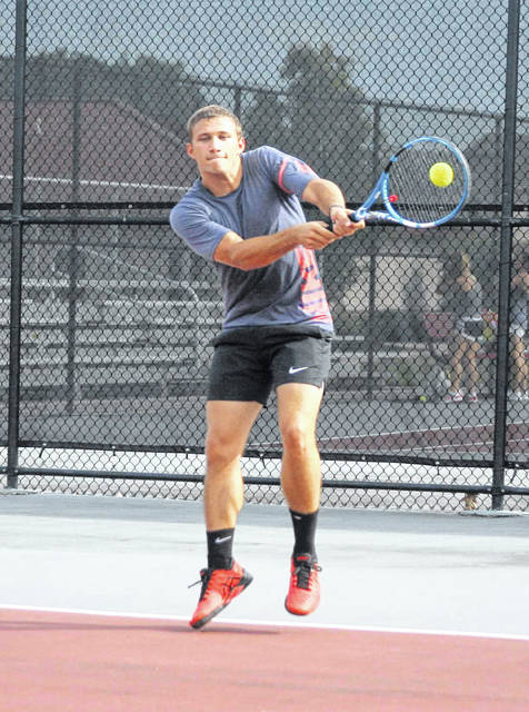 Ada product Zach Beascher fires one back Saturday during the LATA doubles tournament at UNOH.