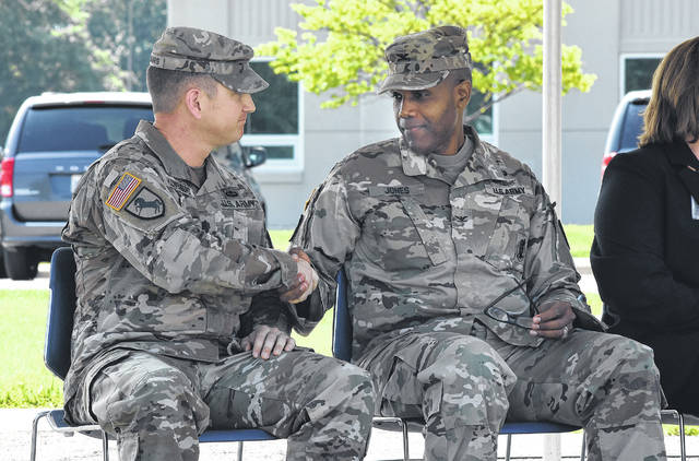 Incoming Commander Lt. Col. George Kloppenburg. left, shakes hands with Col. Humberto Jones after the change of command ceremony Thursday. Kloppenburg most recently served as an executive officer in the Pentagon's procurement division.