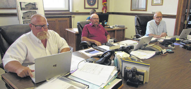 From left are Putnam County Commissioners Michael Lammers, John Schlumbohm and Vincent Schroeder hearing an update Tuesday on a proposed solar farm in Miller City.