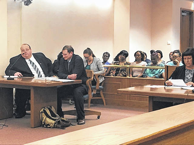 Attorneys from the nationwide human rights organization The Innocence Project, left, appeared in Allen County Common Pleas Court on Tuesday for a hearing seeking a new round of DNA testing of evidence in the 20-year-old murder case of Lima resident Cory Holland.