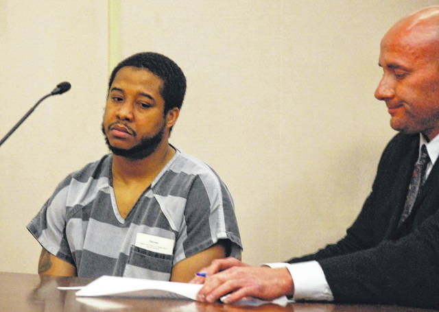 Lima resident Quintel Estelle, charged with murder in Smith's death, waived his right to a speedy trial during a brief court appearance Thursday. He is pictured with his attorney, Stephen Johnston.
