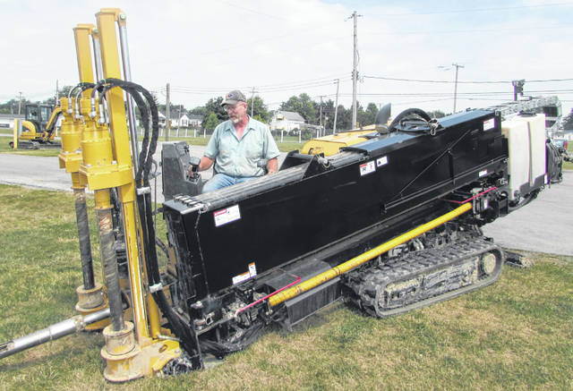 Pictured is Mark Knueven, owner of Knueven Earthworks, using a bore machine to install new water lines at the Putnam County Fairgrounds.