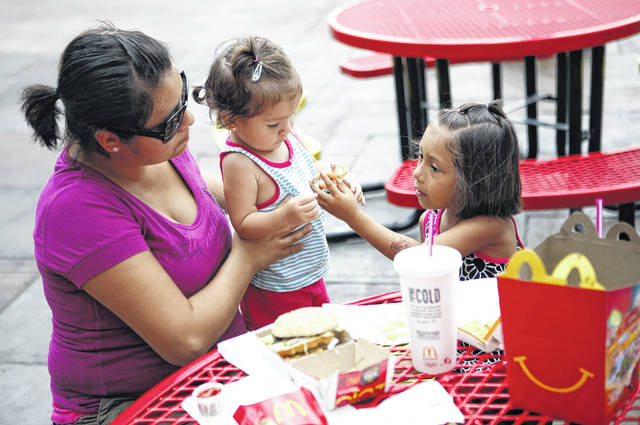 A mom eats lunch with her children outside a McDonald's at Navy Pier in Chicago in 2010.