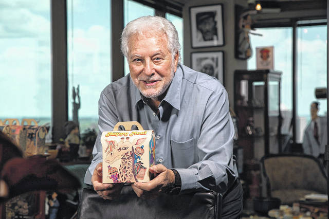 Bob Bernstein holds one of the original Happy Meals boxes he designed for McDonald's 40 years ago.