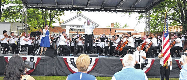 Concertgoers enjoy a previous Lima Symphony Orchestra Patriotic Pops concert in front of Ohio Northern University's McIntosh Center in Ada.
