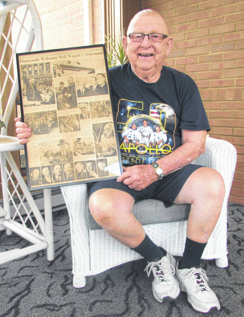 Lewis Erb, a childhood friend of Neil Armstrong's, holds an edition from The Lima News dated April 14, 1966, where his sons Lewis Jr. and Mark were photographed in the parade commemorating Armstrong and were on a truck that carried a rocket float.