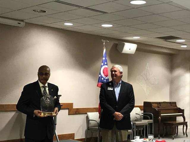 Lima Memorial Health System President/CEO Michael Swick receives an award from American Hospital Association regional executive Kim Byas during the LMH board of directors meeting Wednesday. LMH has been an AHA member for 100 years in 2019.