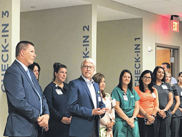Bob Armstrong, senior vice president of operations for Lima Memorial Health System, welcomes staff and patients to Lima Memorial's new heart and vascular institute, which opened Monday.
