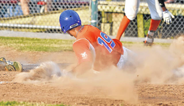 Lima Locos' Zach Sweet slides safely into home plate against St. Clair during Tuesday's game at Simmons Field.