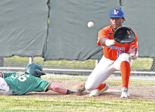 Lima Locos' Colton Frank attempts to pick off St. Clair's Jared Pingitore during Tuesday's game at Simmons Field.
