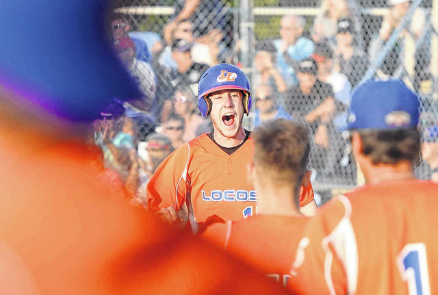 The Lima Locos' Nick Colina reacts after crossing home plate safely Tuesday night during Game 3 of the Great Lakes Summer Collegiate League championship series against Licking County at Simmons Field.