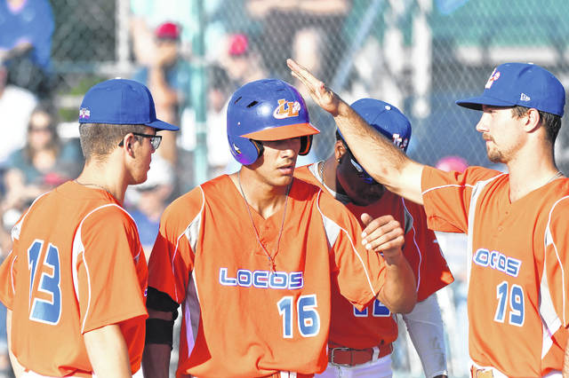 The Lima Locos' Tyler Tolve, center, is congratulated by teammates after scoring a run against the Cincinnati Steam during a June game at Simmons Field. Tolve set a Great Lakes Summer Collegiate League record with 53 RBI this season. Richard Parrish | The Lima News