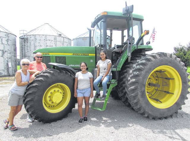 From left are Ottawa residents Emily and Stan Karhoff and Dany, 17, and Ximena Perez, 15, both from Mexico, who are visiting the Karhoffs for three weeks as part of a program.