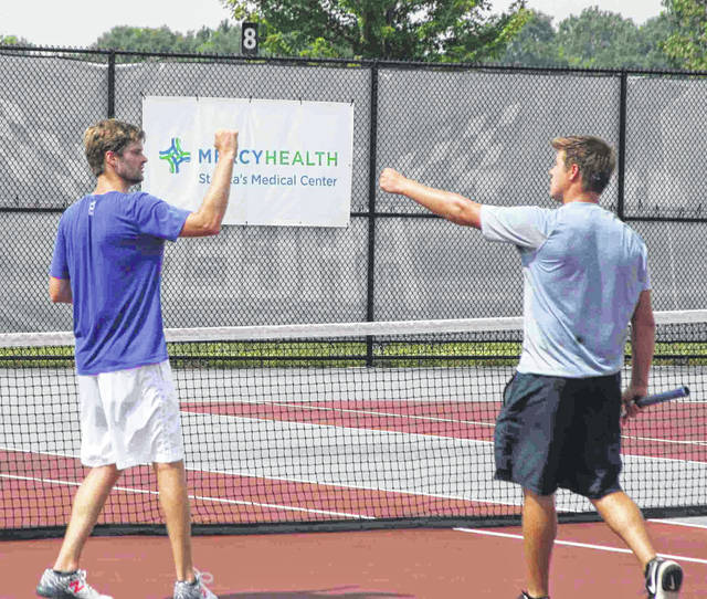 Landon Neuman (left) and Evan Neuman (right) congratulate each other after capturing the LATA men's doubles tournament at University of Northwestern Ohio Sunday.