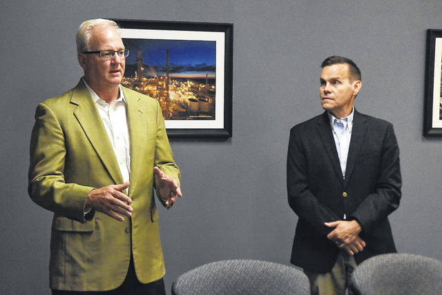 Doug Olsson, left, addresses a press conference at the Greater Lima Region on Thursday. Jeff Sprague, right, has announced his departure as President/CEO of Greater Lima Region Inc. to join the Regional Growth Partnership. Olsson has been to President/CEO.